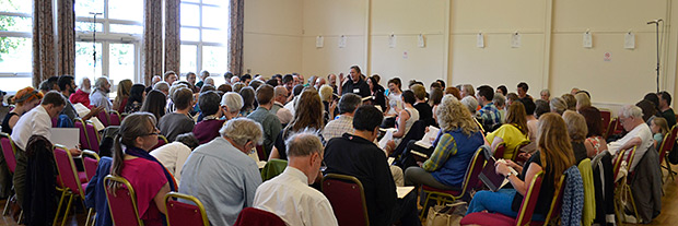 Terry Barber of California leads a large class of singers at the UK Convention. Photograph by Ewan Paterson.