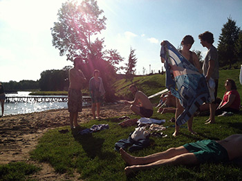 Singers take a quick (and chilly) dip in the lake at Wichrowe Wzgrze before orientation. Photograph by Lauren Bock.